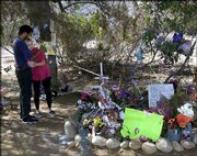 Richard and Michelle Chavez embrace at a memorial for Danielle van Dam, at the site near El Cajon, Calif., where her body was found last February. David Westerfield was found guilty Wednesday of the kidnapping and murder of Danielle, 7.