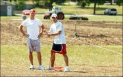 Kansas University program assistants for intramural sports, from left, Kelly Hill, 22, and Derek Gates, 21, work on setting boundaries for some playing fields north of the Shenk Recreational Sports Complex. Shenk fields are being renovated and won't be ready for the start of fall sports.