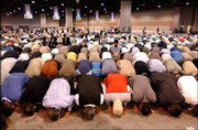 Muslims pray during the Islamic Society of North America's annual convention in Washington. Leaders of the group on Saturday urged Muslim's followers to speak out against violence and to speak up when the Muslim faithful become victims of discrimination.