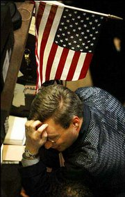 A trader pauses on the floor of the New York Stock Exchange as the closing bell nears. The Dow Jones closed down 355 points on Tuesday.