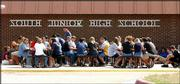 "Students at South Junior High enjoy lunch outdoors Tuesday afternoon. Earlier in the day, Gov. Bill Graves proclaimed September as ""Support Public Schools Month"" in Kansas."