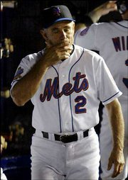 New York Mets Manager Bobby Valentine suffers as the Mets move to within one out from a National League record 15th straight home loss. The Mets set the record Tuesday with a 3-2 loss in 12 innings to the Florida Marlins at Shea Stadium, but ended the skid with an 11-5 victory in the second game of the doubleheader.