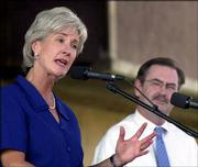 Democratic gubernatorial candidate Kathleen Sebelius makes a point while Republican candidate Tim Shallenburger listens during the race's first debate at the Kansas State Fair in Hutchinson.