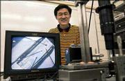 Kansas university professor and researcher Ron Hui has received a patent for newly developed microscopic optical wireless technology. It can be used to generate higher-frequency radio signals that can speed up Internet access.