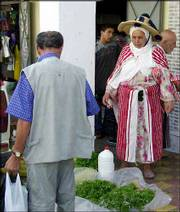 A Berber woman from Morocco's northern Rif Mountains sells fresh mint outside one of the many markets in Tangier.