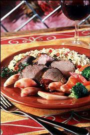 Herbed Pork Tenderloin With Bartlett Pear Port Sauce is a stylish but simple, low-fat entree. Pears in a port-reduction sauce are served with the herbed pork tenderloin, a blend of flavors with a taste of fall in its origins.