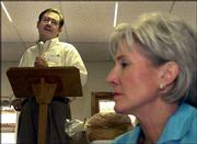 Kansas Republican gubernatorial candidate Tim Shallenburger addresses a gathering at the community center in Hudson while his Democratic opponent, Kathleen Sebelius, listens. The event Tuesday was part of the 2002 Governor's Farm & Ranch Field Day.