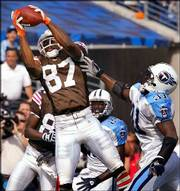 Cleveland wide receiver Andre Davis (87) grabs a 12-yard touchdown pass over Tennessee safety Lance Schulters (31). The Browns went on to defeat the Titans, 31-28 in overtime, on Sunday in Nashville, Tenn.