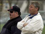 "KU football coach Mark Mangino, left, and LHS football coach Dirk Wedd watch an LHS baseball game in this file photo. Lawrence High officials say they have taken ""appropriate action"" against Mangino after he was involved in an incident after Friday&squot;s LHS-Olathe East football game."
