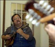 Mandolin instructor Bob Faris leads songbook class at the Americana Music Academy.