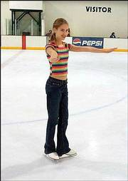 Caroline Blair, 14, has been ice skating for eight months. The Overland Park skater says jumps are her favorite things to do on the ice.