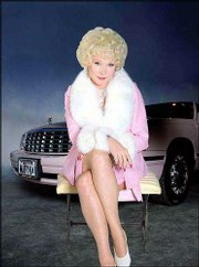 "Actress Shirley MacLaine stars as cosmetics queen Mary Kay Ash in the CBS film ""Hell on Heels: the Battle of Mary Kay."" Ash was known for her love of things pink, including cars like the Cadillac in the background."