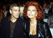 Actor George Clooney, left, and Italian actress Sophia Loren attend the Giorgio Armani Spring-Summer 2003 fashion collection in Milan, Italy.