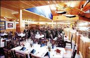 From 4 p.m. to 8 p.m. Monday through Saturday, six tables are set aside for fine dining at Cabela's Yukon Base Camp Grill. The menu features exotic meats such as elk, buffalo and quail.