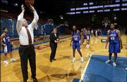 KU athletic director Al Bohl, left, shoots hoops during a break in media day at Allen Fieldhouse as assistant Maggie Mahood, middle, and Nichelle Roberts look at.