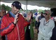 Kyle Petty, left, jokes with Paul Newman before a ceremony to commemorate the beginning of construction of the Victory Junction Gang Camp. The two visited Tuesday in Randleman, N.C.