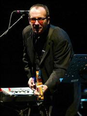 Elvis Costello and the Imposters performed for avid fans Wednesday night at Kansas City's Midland Theatre.