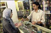 A young Iranian woman purchases a music cassette in Tehran. An $8 million, U.S.-funded radio station is preparing to reach out to young Iranians. The broadcasts, scheduled to begin early next year, are another attempt by Washington to use youth-oriented media to bolster America's sagging image in the Islamic world.