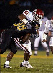 Oklahoma linebacker Lance Mitchell (10) tackles Missouri tailback Zack Abron in this October 5 file photo. Mitchell had 19 tackles in the game and is Oklahoma's leading tackler with 62.