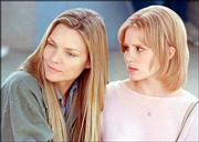 "Michelle Pfeiffer, left, and Alison Lohman star in the drama ""White Oleander."""