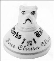 Cowles Syndicate Inc. Union Porcelain Works operated in Greenpoint, N.Y., from 1848 to 1900. This 3-inch-high porcelain paperweight with a bulldog head is an advertisement showing the company trademark and name. It auctioned in July for $650.