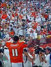 Miami quarterback Ken Dorsey acknowledges the crowd after the Hurricanes came from behind to defeat Florida State. Top-ranked Miami topped the No. 9 Seminoles, 28-27, Saturday at the Orange Bowl in Miami.