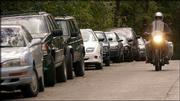 Cars line the east side of Edgehill Road near Kansas University, leaving no space for parking. Resident Steven Watts has asked the city commission to establish a no-parking zone in front of his house to combat motorists who block his driveway.