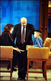 "Psychologist Phil McGraw talks with guests Kathy, left, and her son Vincent on the talk show ""Dr. Phil,"" which has garnered the best ratings of any talk show since Oprah Winfrey debuted in 1986. The syndicated show started nationally Sept. 16."