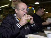 Jerry Hahn, Monticello, Iowa, takes a bite of a turkey sandwich during his lunch break at the Reading Terminal Market in Philadelphia. Poultry processor Pilgrim's Pride is recalling 27.4 million pounds of cooked sandwich meat. Hahn said Monday that he knew about the recall but was not concerned.