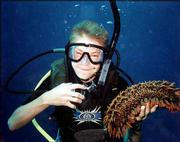 "Thomas secured a sea cucumber on his first dive after becoming a certified diver. His advice to anyone interested in diving: ""Don't get scared about the depth. The almost weightless experience is worth it."""