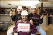 Dunkin Donuts, 521 W. 23rd St., is closed for a rebuilding project. The owners, from left, Lala Patel, Sonny Patel and Dee Patel, are pictured in the building Wednesday. The building will be torn down during the next week. A new building is scheduled to be built with a drive-through window and outdoor patio.