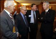 Former Kansas governors, from left, William Avery, John Anderson Jr. and Mike Hayden, visit with Gov. Bill Graves before a discussion at the Kansas Economic Policy Conference at Kansas University. Thursday's conference at the Dole Institute of Politics provided a dark outlook of Kansas' financial future.