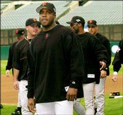 San Francisco's Barry Bonds, center, and teammates take the field for practice. The Giants worked out Thursday at Edison Field in Anaheim, Calif.