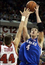 Nick Collison (4) thought about leaving KU for the NBA last season, but decided to return in order to bulk up to be able to better compete with the pro front-liners.