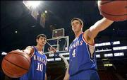 Kansas University seniors Kirk Hinrich, left, and Nick Collison considered jumping to the NBA last season. Both ultimately decided to return to the Jayhawks, citing the need to get stronger in preparation for the grind of professional basketball.