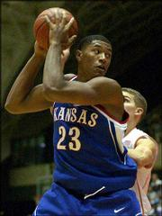 Kansas sophomore Wayne Simien, a Leavenworth native, heads to the hoop during a game last season.