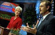 Democratic gubernatorial candidate Kathleen Sebelius, left, listens as Republican candidate Tim Shallenburger responds to a question during a debate at the WIBW-TV studios in Topeka. Tuesday's debate was the last time the two gubernatorial candidates will square off face-to-face before the Nov. 5 election.