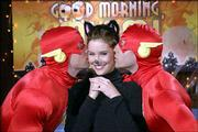 "Ashley Williams gets kissed by Matt Letscher, left, and Mark Feuerstein in the Halloween episode of NBC&squot;s romantic comedy ""Good Morning Miami."" Williams portrays a pixyish hairstylist for a local morning TV show in the sitcom."