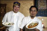 Alejandro Lule, left, and Subarna Bhattachan show off some dishes at their restaurant Zen Zero, 811 Mass. The co-owners describe Zen Zero as a Pan-Asian restaurant featuring foods from Nepal, Tibet, Thailand, Vietnam and Japan with other cultural influences mixed in.