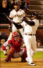 San Francisco's Barry Bonds watches his two-run homer off Anaheim's Ramon Ortiz in Game 3 of the World Series. The Angels won, 10-4, Tuesday in San Francisco, Calif.