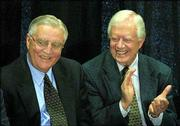 Former Vice President Walter Mondale, left, is applauded by former President Jimmy Carter at a ceremony to dedicate a hall named in Mondale's honor at the University of Minnesota Law School in Minneapolis in this May 17, 2001, file photo. The family of late Sen. Paul Wellstone has asked Mondale to replace Wellstone on the Nov. 5 ballot, and Mondale is likely to accept, according to a source who has spoken to Mondale.