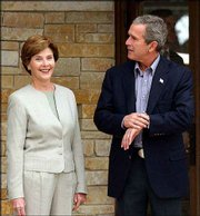 President Bush and first lady Laura Bush are shown at their ranch in Crawford, Tex. The Bushes were waiting last week for a visit by Chinese President Jiang Zemin. The president at times gets himself in hot water with both his critics and his wife for his terms of endearment.