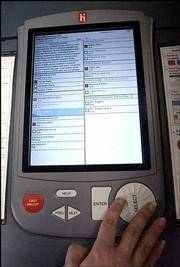 Voters in Harris County, Tex., are going high tech. Instead of perforating punch cards, voters will use electronic machines when they go to the polls Nov. 5.