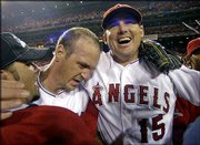Anaheim closer Troy Percival, center, and Tim Salmon celebrate with teammates. The Angels won Game 7 of the World Series, 4-1, against San Francisco to win the championship Sunday in Anaheim, Calif.