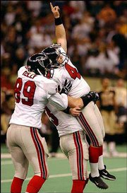 Atlanta Falcons kicker Jay Feely (4) is hoisted into the air by holder Chris Mohr and tight end Reggie Kelly (89) after making the game-winning field goal as time expired. The Falcons defeated the New Orleans Saints, 37-35, on Sunday at the Superdome in New Orleans.
