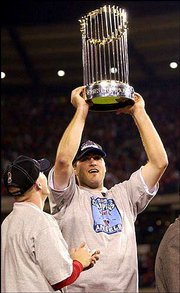 World Series MVP Troy Glaus holds the hardware. Glaus was named MVP after the Angels beat San Francisco, 4-1, on Sunday in Anaheim, Calif.