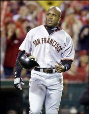 San Francisco's Barry Bonds throws his helmet after being stranded on base in the fourth inning. The Giants lost Game 7 of the World Series, 4-1, to the Angels on Sunday in Anaheim, Calif.