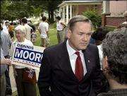 U.S. Rep. Dennis Moore, D-Kan., is facing a moderate for the first time in his bid to remain the 3rd Congressional District representative. Moore is shown campaigning in East Lawrence in this photo from August.