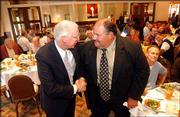 Kansas State coach Bill Snyder, left, greets Kansas coach Mark Mangino during the Greater Kansas City Sports Commission luncheon last August. Mangino will meet his former boss again Saturday when KU plays host to K-State.