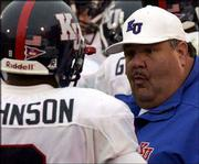 Kansas University coach Mark Mangino talks to Remuise Johnson after a punt return during last Saturday's game at Missouri. Mangino will face his former boss, Kansas State coach Bill Snyder, Saturday when Kansas plays host to Kansas State.
